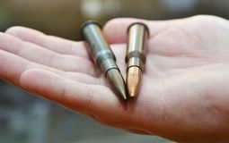Hands of bullets Royalty Free Stock Images