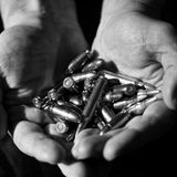 Hands with Bullets Royalty Free Stock Image