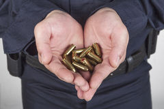 Hands with bullets Stock Photos