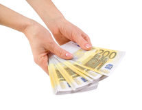 Hands with a bundle of banknotes. Two hundred euros Stock Photo