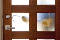 Burglar with crowbar at house door stock photos