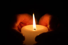 Hands with burning candle. Hands holding a burning candle at night Royalty Free Stock Photos
