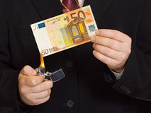 Hands and burnning money Stock Photography