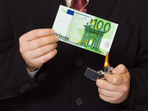 Hands and burnning money. Business concept Stock Photos