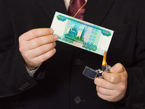 Hands and burnning russian money Stock Image
