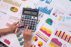 Hands of business analyst calculating graphs. And diagrams royalty free stock photos