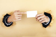 Hands and business card Stock Image