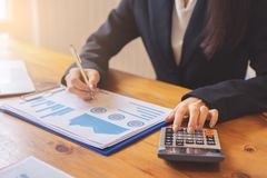 Hands of business executives discussing financial reports. And using calculator stock images