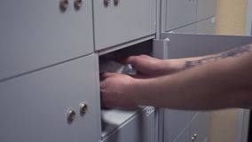 Hands of business group puts plastic envelopes into bank depository cell stock footage