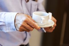Hands business man hold cup of coffee. royalty free stock image