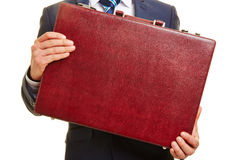 Hands of business man holding briefcase Stock Image