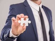 Hands. Business man holding piece of puzzle on white background. Business solution concept Stock Photos