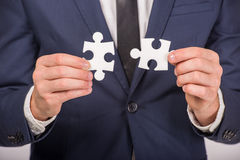Hands. Business man holding pieces of puzzle on white background. Business solution concept Stock Photo