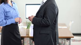 Hands of business people doing gestures while talking. Hands of two business people doing gestures while talking in the office (Full HD stock video