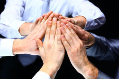 Hands of the business people forming a pyramid Royalty Free Stock Photography