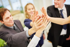 Hands of business people giving a high five royalty free stock photo