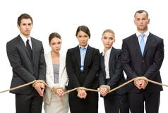 Hands of business people are tied with rope Stock Image