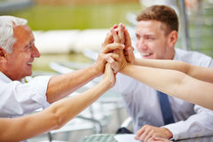 Hands of business team giving high five Royalty Free Stock Photo