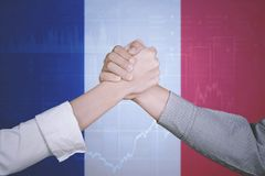 Successful business team with South Korea flag. Hands of business team posing partnership near a growth graph and South Korea flag. Symbolizing of peace stock image