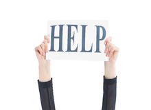Hands business woman holding a poster with the words - help Royalty Free Stock Image