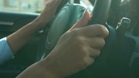 Hands of business woman holding steering wheel, driving vehicle, traffic jam. Stock footage stock video footage