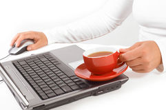 Hands of business woman with mouse and coffee Royalty Free Stock Photo