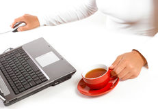 Hands of business woman with mouse and coffee Royalty Free Stock Photography
