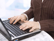 Hands of a business woman on notebook keyboard Royalty Free Stock Images