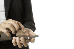 Hands of business woman using a mobile phone. Closeup of hands of business woman using a mobile phone - focus on the right hand Royalty Free Stock Photo