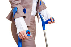 Hands of woman walking. Hands of a business woman walking with two crutches Stock Images