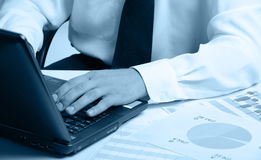 Hands of the businessman above the keyboard laptop royalty free stock photography