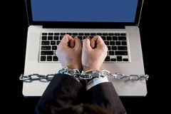 Hands of businessman addicted to work bond with chain to computer laptop in workaholic Stock Image