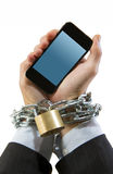 Hands of businessman addicted to work chain locked in mobile phone addiction Royalty Free Stock Photos