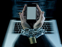 Hands of businessman addicted to work locked and enchained in mobile phone addiction Royalty Free Stock Photos