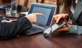 Hands of businessman and businesswoman with laptop,mobile  tablet. Stock Images