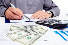 Hands of businessman with calculator. Royalty Free Stock Image