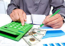 Hands of businessman with calculator. Stock Photos