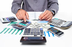Hands of businessman with calculator. Stock Photo