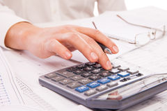 Hands of businessman with calculator Stock Photography