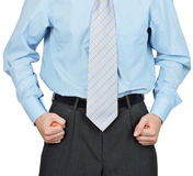 Hands of businessman clenched in fists Stock Photos