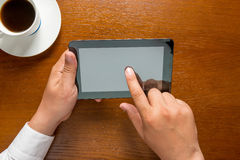 Hands of a businessman and computer tablet Stock Photos
