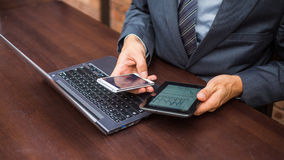 Hands of businessman with laptop,mobile phone and tablet. Royalty Free Stock Photo