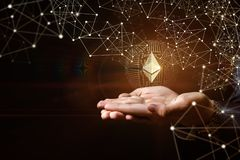 Hands of businessman support ethereum. On a dark background royalty free stock images