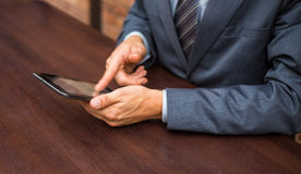 Hands of businessman with tablet. Stock Photography