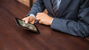 Hands of businessman with tablet. Stock Photo