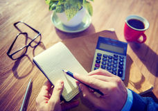 Hands of Businessman Working with Calculator Stock Photo