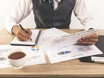 Hands of Businessman working with Data Charts royalty free stock photo