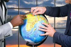 Hands of businessmen touch globe. Stock Photos