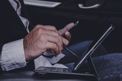 Hands of businessmen are working with laptops on cars.while traveling stock photos