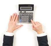 Hands businesswoman and grey calculator Royalty Free Stock Images